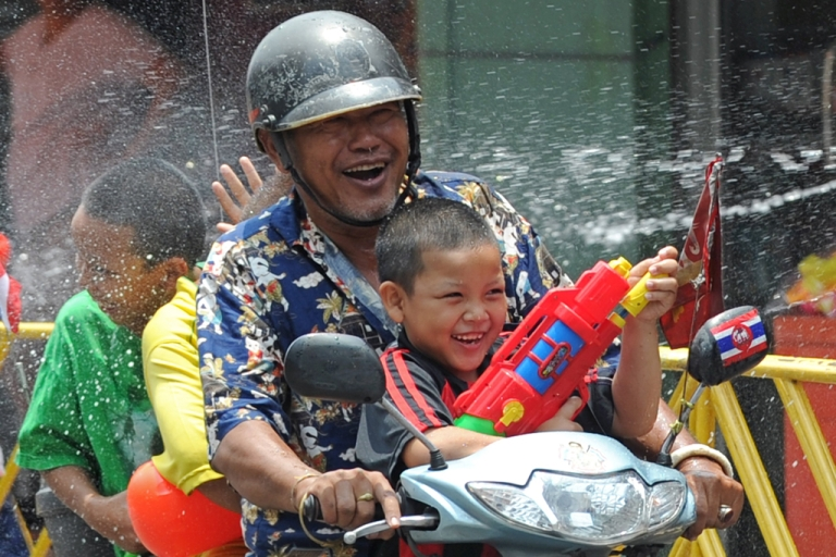 <p>Thai children spray water at each other on Khaosan road during Songkran festival in Bangkok on April 12, 2011.</p>