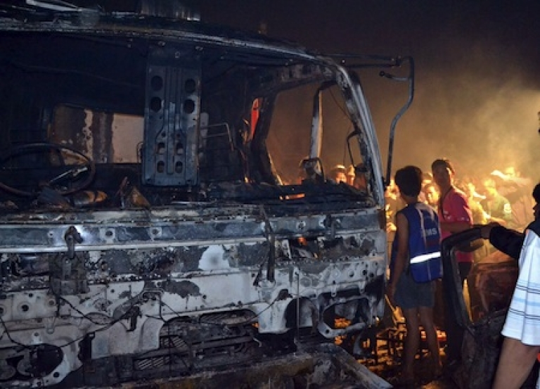 <p>Members of Thai rescue workers look at the wreckage of a truck after an accident caused by fireworks during celebrations of the Chinese New Year in Suphan Buri province 100 kilometres (60 miles) north of Bangkok.</p>