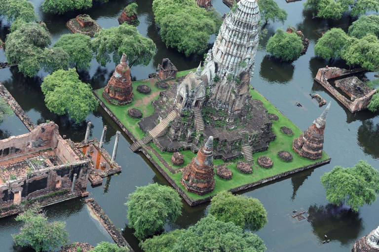 <p>This aerial picture shows a temple surrounded by flood waters in the ancient capital city of Ayutthaya, north of Bangkok, on October 16, 2011. Flood defenses protecting the Thai capital held up on October 16, but the advancing waters that have swamped the inland still threaten to engulf Bangkok in a disaster that has claimed 300 lives. Thailand's worst floods in decades have inundated huge swathes of the kingdom, swallowing homes and businesses, shutting down industry, and forcing tens of thousands of people to seek refuge in shelters.</p>