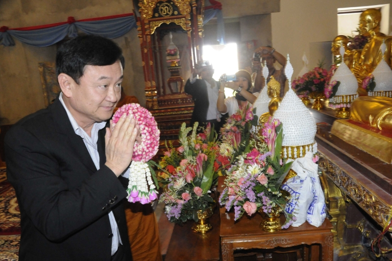 <p>Former Thai prime minister Thaksin Shinawatra during a visit to the Wat Pa Monastery in Bodh Gaya in India's Bihar state on Nov. 4, 2011. Thaksin made a religious visit to the Buddhist pilgrimage site.</p>