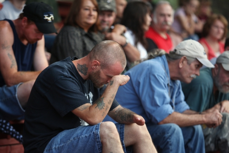 <p>James Smith from Pound, Virginia, rubs his head while waiting for dental services with hundreds of others at the Remote Area Medical clinic July 27, 2008 in Wise, Virginia. Pound said he was born with birth defects due to thalidomide.</p>
