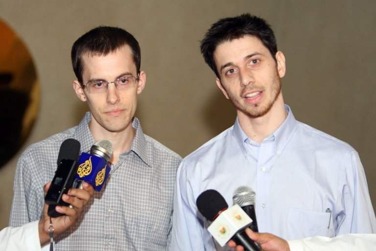 <p>Shane Bauer (left) and Josh Fattal in Oman after their release from Iran.</p>
