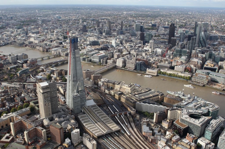 <p>An aerial view of London shows the unfinished Shard skyscraper towering above the rest of the skyline.</p>