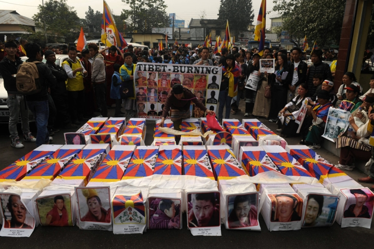 <p>Tibetans offer prayers near mock coffins to represent the victims of self-immolation during a rally in Siliguri today. China said it would 'resolutely crack down' on any attempts to instigate violence in Tibetan-inhabited areas, where authorities have launched a deadly clampdown on protesters.</p>
