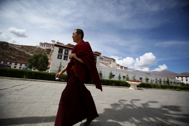 <p>A Tibetan Buddhist monk walks on the Potala Palace square on June 19, 2009 in Lhasa, Tibet Autonomous Region, China. Traditionally, Lhasa is the seat of the Dalai Lama, the capital of Tibet and is the highest capital in the world. The Potala Palace was the chief residence of the Dalai Lama until the 14th Dalai Lama fled to Dharamsala, India, in 1959.</p>