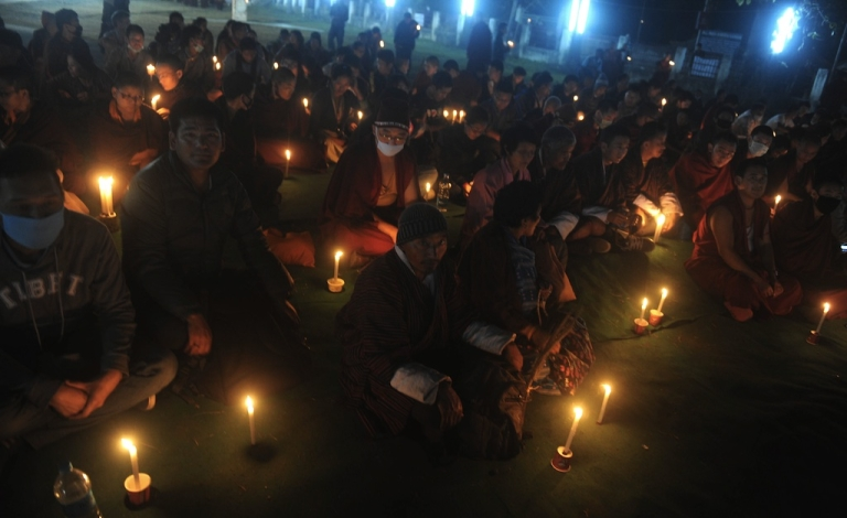 <p>Buddhists attend a candle vigil by the Tibetan Community in memory of self immolations in Tibet during the eighth day of the Kalachakra Festival in Bodhgaya on January 8, 2012. Kalachakra 2012, a festival of teachings and meditations will take place from January 1, 2012 for ten days in the northern Indian state of Bihar and will be attended by Tibetan Spiritual Leader The Dalai Lama.</p>