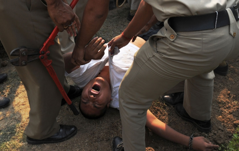 <p>A protester, identified as Sherab Tsedor, screams as he is dragged away by Indian police moments after he tried to set himself on fire in front of the Chinese embassy in New Delhi on November 4, 2011.</p>