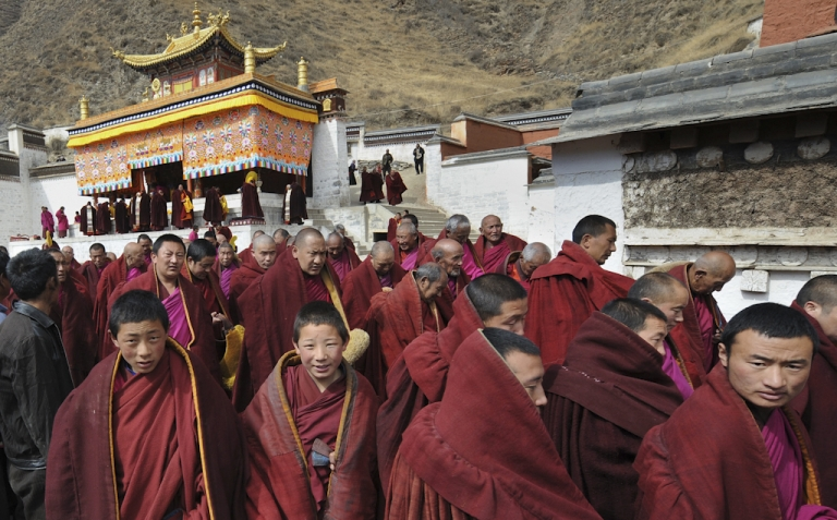 <p>Tibetan Buddhist monks leave a ceremony at the historic Labrang Monastery, which is second only to the Potala Palace in Lhasa in size, in the town of Xiahe, Gansu Province on March 14, 2008.</p>