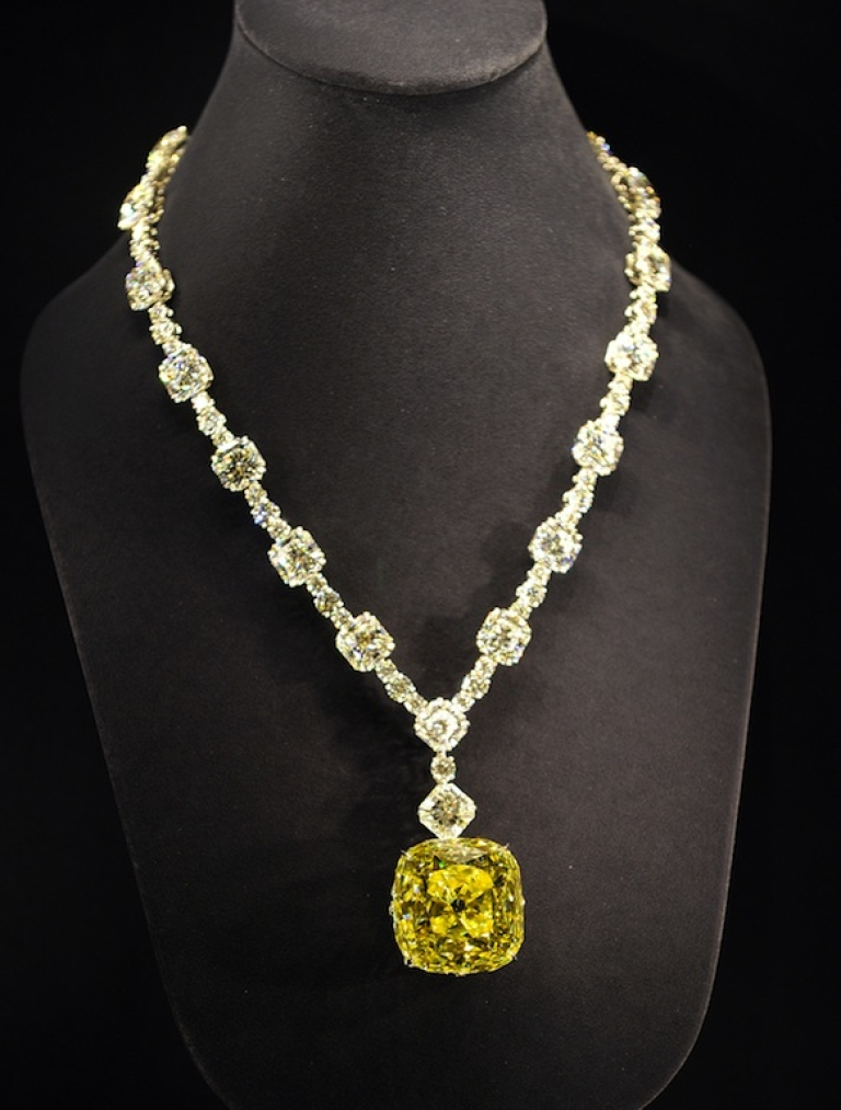 <p>Tiffany &amp; Co displays a diamond necklace with a 128.54 carat yellow diamond at a reception to celebrate the company's 175th anniversary in Tokyo on May 16, 2012.</p>