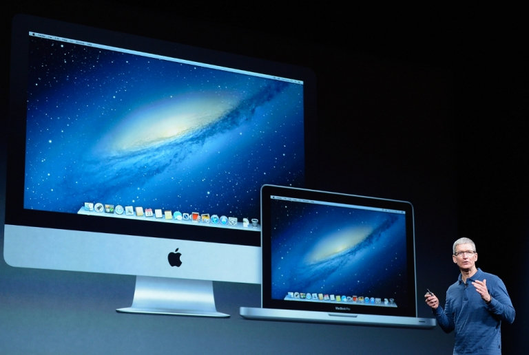 <p>Apple CEO Tim Cook speaks with Apple products displayed on a large screen during an Apple special event at the historic California Theater on October 23, 2012 in San Jose, California.</p>