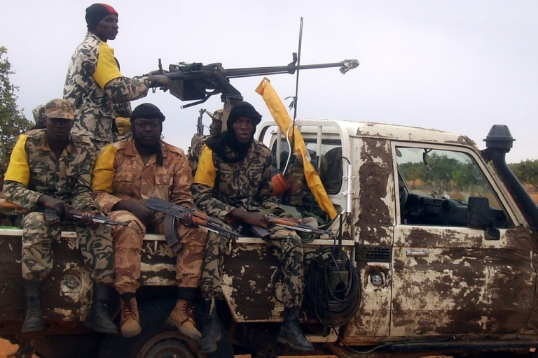 <p>Malian troops after a military raid dislodged Al Qaeda in the Islamic Maghreb (AQIM) from its newly-built base in the Wagoudou forest in July 2011. In late November AQIM kidnapped four tourists and murdered one near Timbuktu.</p>
