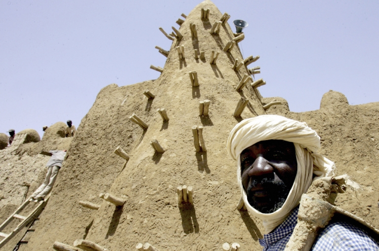 <p>Mali's Tuareg rebels have declared northern Mali to be the independent state of Azawad. The contested area includes the fabled center of Timbuktu. Here a resident of Timbuktu walks past the restored City of 333 Saints Djingareyber Mosque.</p>