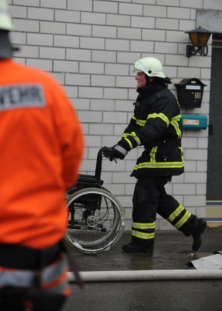 <p>A firefighter at the scene of the fire at a training center for disabled people in Titisee-Neustadt, southern Germany, on Nov. 26, 2012.</p>