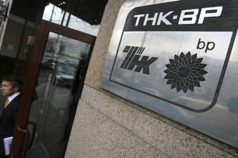 <p>A man exits the offices of British-Russian oil giant TNK-BP in central Moscow.</p>