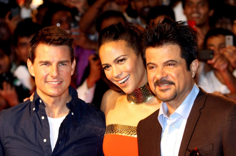 <p>Tom who?  I'm know the guy on the right is Anil Kapoor, the star of Mr. India and other Bollywood hits, and I'm pretty sure the woman in the center is Paula Patton.  But I'm a little fuzzy about the guy on the left.</p>