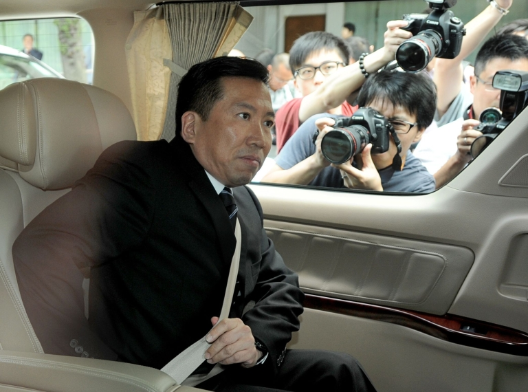 <p>Fengshui master Tony Chan Chun puts his seatbelt on as he leaves the Eastern Court in Hong Kong on May 14, 2012.</p>