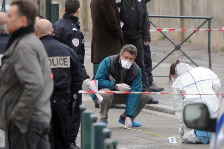 <p>Police forensic teams working outside the Jewish school in Toulouse where three children and a rabbi were murdered today.</p>