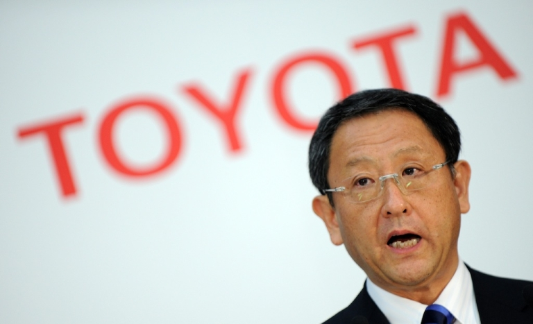 <p>Toyota president Akio Toyoda delivers a speech during a press conference at the company's head office in Tokyo on May 9, 2012.</p>