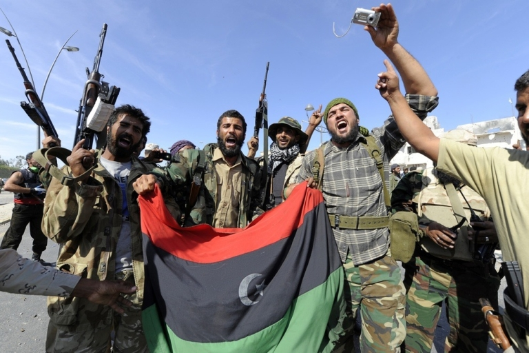 <p>Fighters celebrate the fall of Sirte.</p>