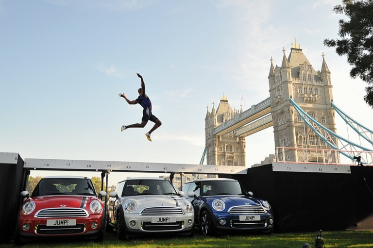 <p>London 2012 Olympics long jump hopeful British athlete J.J. Jegede successfully jumps over the roof of three MINI cars in central London, on September 28, 2011.</p>