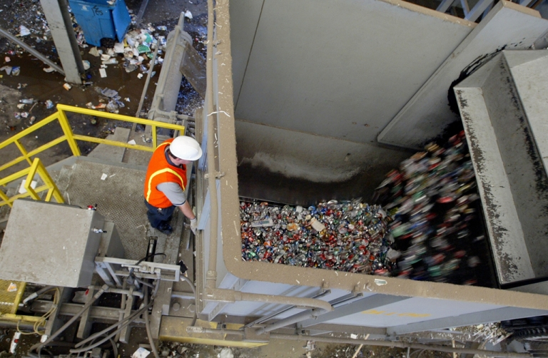 <p>A woman who fell into her garbage chute trying to retrieve her cellphone was saved by trash, officials said.</p>