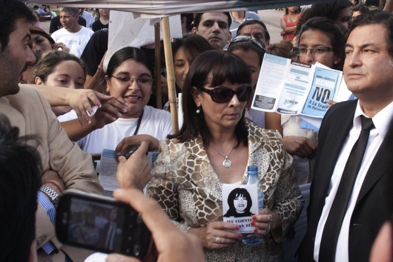 <p>Susana Trimarco (C), mother of disappeared Maria de los Angeles 'Marita' Veron, holds her portrait as she enters the Court in Tucuman, Argentina, on December 11, 2012. The 13 people accused of the kidnapping of Veron were found not guilty, prompting mass protests and at least one political resignation.</p>