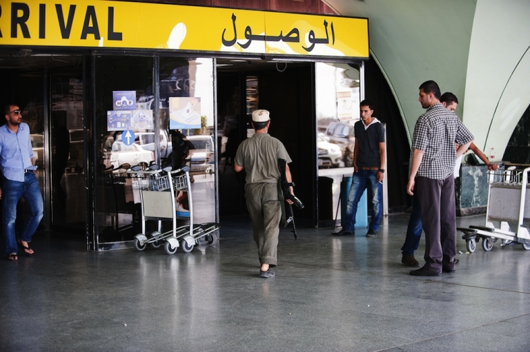 <p>An unidentified armed man walks towards the arrivals hall inside Tripoli's international airport on June 4, 2012 after it was overrun by the al Awfea militia of Libyan ex-rebels who surrounded planes with tanks, grounding all flights following their leader's apparent arrest, according to officials. The official Lana news agency, citing witnesses, confirmed the 'assault' by gunmen who fired into the air and slightly wounded an airport employee, causing panic among travellers.</p>