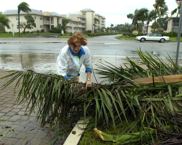 <p>Karen Pennland and walks in the rain and wind from Tropical Storm Fay August 19, 2008 in Fort Myers Beach, Florida. Tropical Storm Debby has Florida, Alabama and Louisiana on storm watch as it lashed the Gulf coast with heavy winds and rain Sunday.</p>