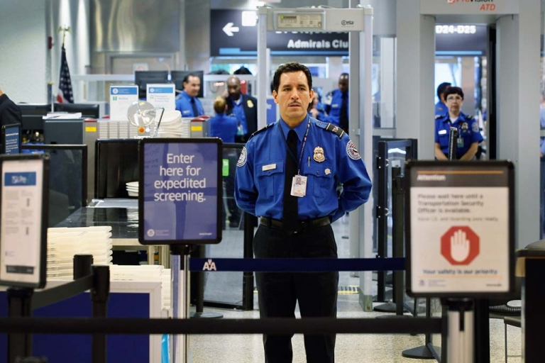 <p>A TSA agent waits for passengers to use the TSA PreCheck lane being implemented by the Transportation Security Administration at Miami International Airport on October 4, 2011 in Miami.  (Photo by Joe Raedle/Getty Images)</p>