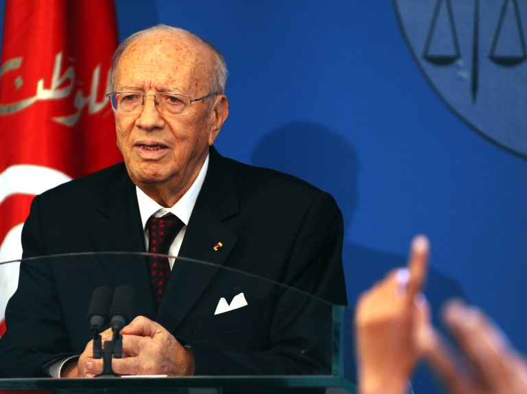 <p>Tunisian Prime Minister Beji Caid Essebsi speaks during a press conference after unveiling the new government on March 7, 2011 in Tunis.</p>