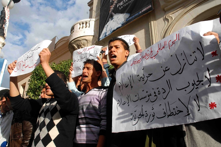 <p>Tunsian journalists demostrate in front of the municipal theatre in Tunis after the president of the National Union of Tunisian Journalists (SNJT), Neji Bghouri, presented on May 3, 2011 on World Press Freedom Day, the annual report on press freedom in Tunisia. The fall of the police state in the Tunisian uprising in January has left journalists seeking new sources and points of reference for their work, demanding the right to a free press.</p>