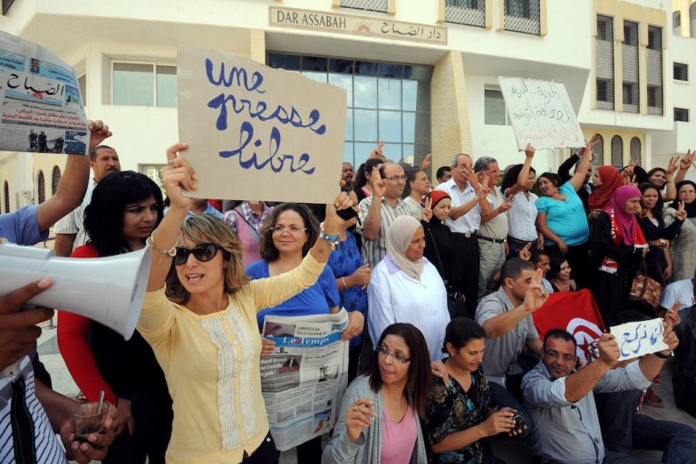 <p>Tunisian journalists of Assabah Daily hold signs calling for freedom of the press during a protest in Tunis on September 11, 2012. Since the government appointed overseers for the country's media outlets, journalists have held a number of protests and recently had a general strike.</p>