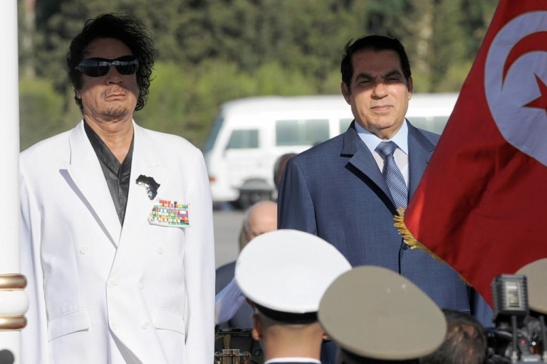 <p>Former Tunisian president Zine Al Abidine Ben Ali stands with Libyan leader Moamer Kadhafi upon his arrive on August 03, 2008 in Tunis.</p>