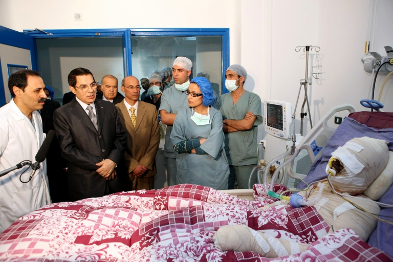 <p>Tunisian President Zine El-Abidine Ben Ali looking at Mohamed Al Bouazizi, during his visit at the hospital in Ben Arous near Tunis on Dec. 28, 2010. Mohamed Al Bouazizi, 26, was a college graduate who became a street fruit vendor when he couldn't find other work. He doused himself in gas and set himself on fire on Dec. 17, 2010, and died of his burns on Jan. 4 of the following year. Al Bouazizi's self-immolation provoked the demonstrations that would go on to sweep the Middle East.</p>