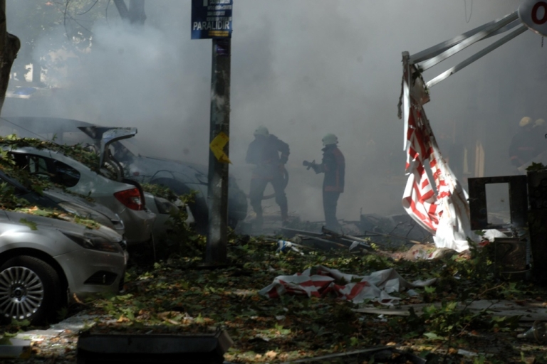 <p>Turkish firefighters work at the site where a suspected car bomb exploded, wounding more than a dozen people in the center of the Turkish capital Ankara.</p>