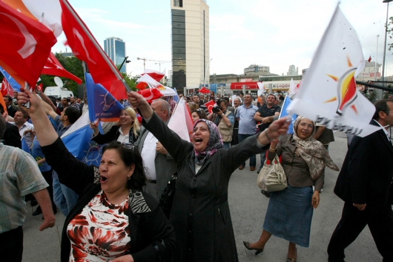 <p>Supporters of Turkey's ruling AKP party celebrate after the first results of the parliamentary election, in Ankara, on June 12, 2011. The AKP took a 54.8-percent lead in today's general polls, with 30 percent of the vote counted.</p>