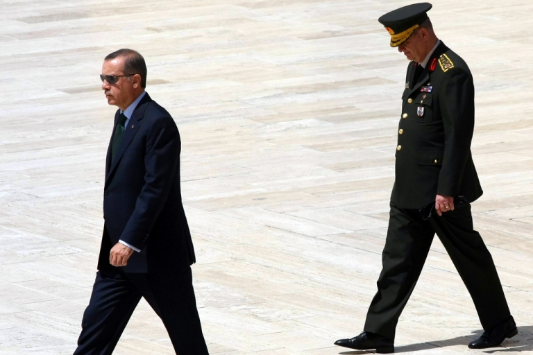 <p>Turkey's Prime Minister Tayyip Erdogan (L) leaves after a wreath-laying ceremony as he is flanked by Chief of Staff General Ilker Basbug (R) at the mausoleum of Mustafa Kemal Ataturk, founder of modern Turkey, in Ankara on Aug. 1, 2010.</p>