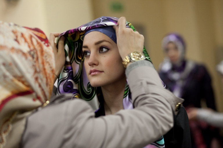 <p>Backstage, Eastern European models get outfitted for a fashion show at the Islamic Fashion Expo on March 3, 2011.</p>