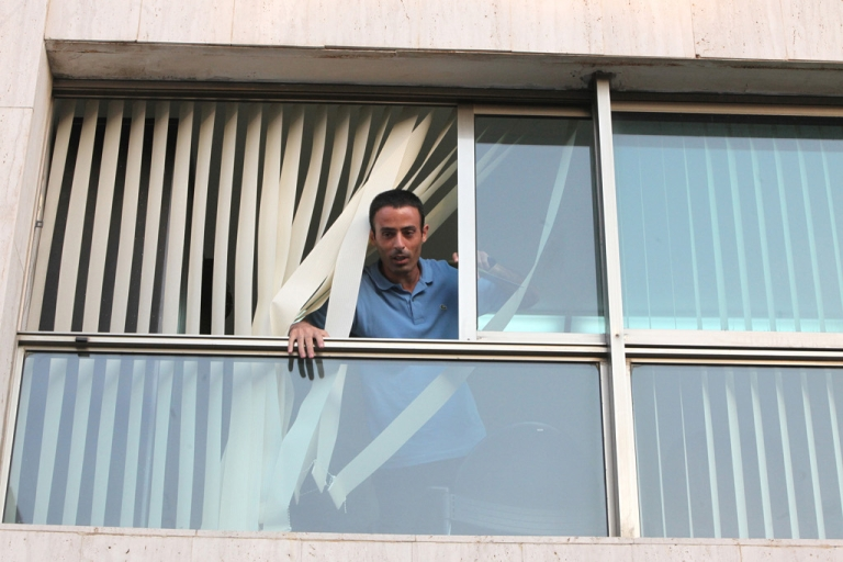 <p>Palestinian Nadim Injaz is seen at the window of the Turkish Embassy in Tel Aviv, on August 17, 2010. Injaz, allegedly carrying a knife and a toy gun broke into the embassy and attempted to take a diplomat hostage before being overpowered by security, Turkish officials and media said.</p>