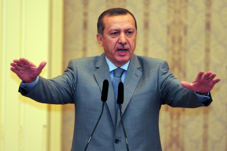 <p>Turkish Prime Minister Recep Tayyip Erdogan gestures as he speaks during a conference in Istanbul on Aug. 17, 2011.</p>