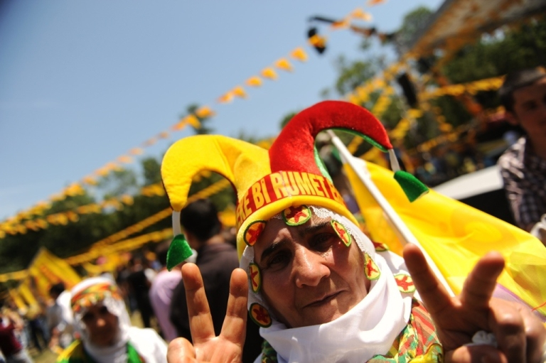 <p>A Kurdish supporter of the Labor, Freedom and Democracy Platform flashes a peace sign during an election rally in Istanbul on June 5, 2011.</p>