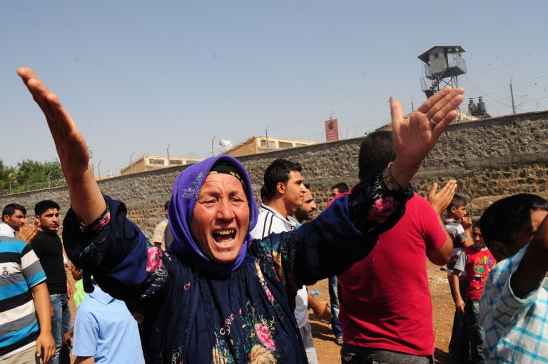 <p>A relative of a prisoner cries in front of Sanliurfa city prison on June 17, 2012.</p>