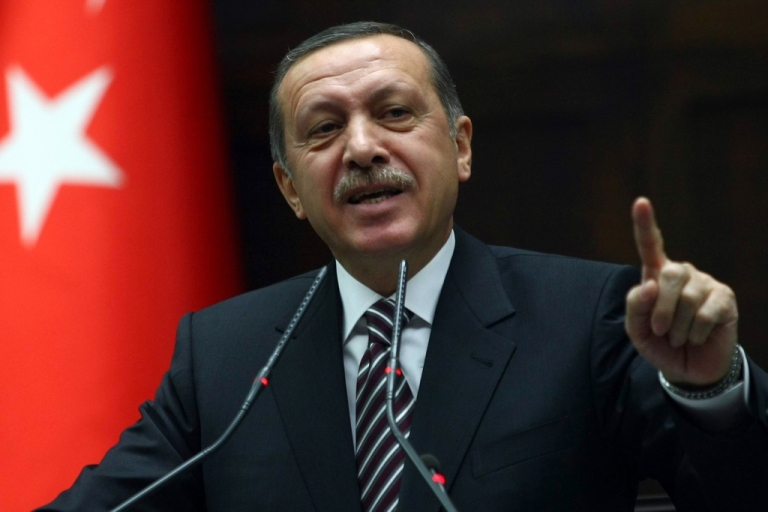 <p>Turkey's Prime Minister Recep Tayyip Erdogan gestures while addressing parliament on the issue of Syria on Nov. 15, 2011.</p>