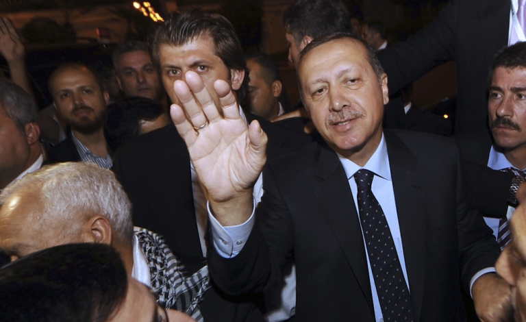 <p>Turkish Prime Minister Recep Tayyip Erdogan waves upon his arrival on September 14, 2011 in Tunis. Erdogan is on a three-day official visit to Tunisia.</p>