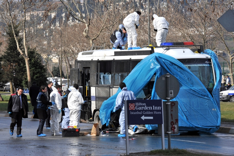 <p>Turkish forensic police search near the bus after an explosion in Istanbul, on March 1, 2012. A remote-controlled bomb explosion near a police bus wounded 10 people, mostly policemen, in Istanbul early Thursday, in what seems to be an attack targeting security forces, Istanbul police said.</p>