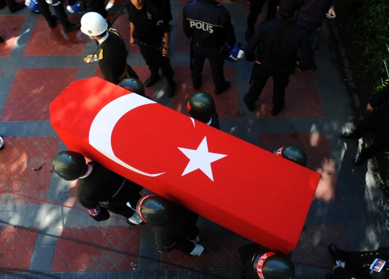<p>Turkish soldiers carry the coffins of slain soldiers Eyup Colakoglu, as hundreds of people attend the funeral of two Turkish soldiers who were killed in an attack by Kurdish rebels in southeastern Turkey, in Istanbul, on October 21, 2011. Mourning Turkey paid its last respects to 24 soldiers killed by Kurdish rebels on the Iraq border as the Turkish air force pounded rebel camps in northern Iraq.</p>