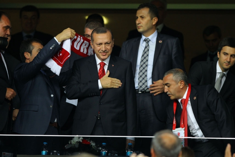 <p>Turkey's Prime Minister Tayyip Erdogan arrives in the stands before the FIFA World Cup 2014 qualification football match between Turkey and Romania in Istanbul, on October 12, 2012.</p>