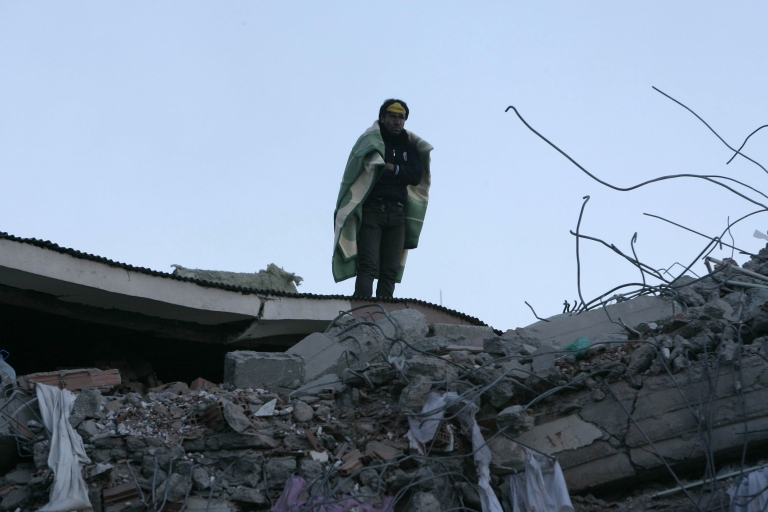 <p>A quake survivor stands amid the rubble of a building in Van, eastern Turkey, on Oct. 24, 2011.</p>