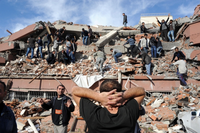<p>Residents of Tabanli village in the Van Province in eastern Turkey rush to rescue survivors of a a 7.2-magnitude earthquake on Oct. 23, 2011.</p>