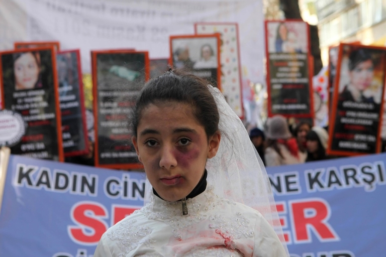 <p>A Turkish girl wearing a wedding dress and covered with fake bruises stands in front of other protesters holding placard reading ''end violence'' during a demonstration to protest against rape, killings and domestic violence against women, in Ankara in 2011. A recent rape case has brought the topic of rape to the forefront of political debate again.</p>